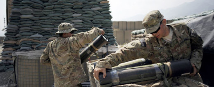 Soldiers of the 4th brigade combat team 4th infantry division of the US Army clean a mortar range at the Forward Operating Base Joyce, in the Kunar province of Afghanistan. Picture: AFP
