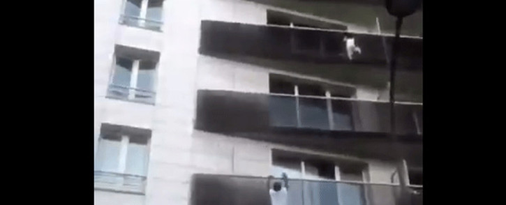 A screengrab shows Mamoudou Gassama climbing up a balcony to save a four-year-old child in Paris. Picture: @kariff_m/Twitter