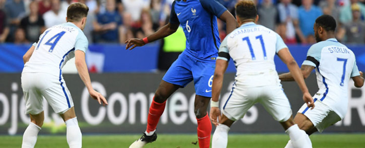 France midfielder Paul Pogba (C) controls the ball under pressure from England midfielders Aaron Cresswell (L), Alex Oxlade-Chamberlain (2R) and Raheem Sterling (R) during their international friendly match. Picture: AFP