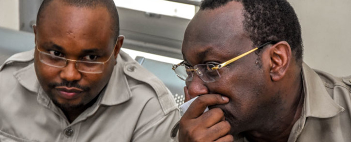 Chadema party chairperson Freeman Mbowe (R) and general secretary John Mnyika sit in the dock at Kisutu resident magistrates court in Dar es Salaam on 10 March 2020. Picture: AFP