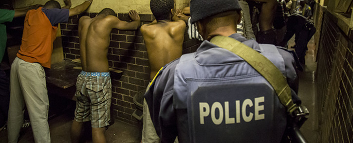 Police detain and search hostel dwellers in Jeppestown during a joint raid with the army to quell xenophobic violence. Picture: Thomas Holder/EWN