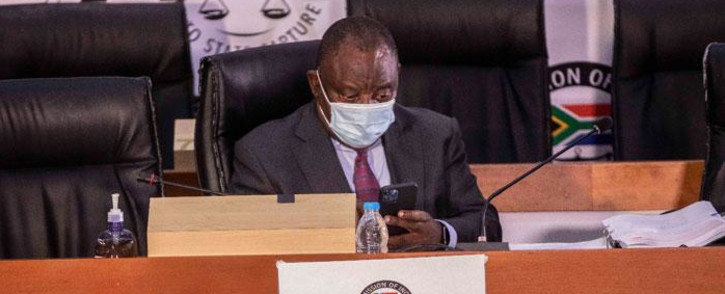 President Cyril Ramaphosa checks his phone ahead of the start of proceedings on his second day of testimony at the state capture inquiry on 29 April 2021 in Braamfontein, Johannesburg. Picture: Abigail Javier/Eyewitness News