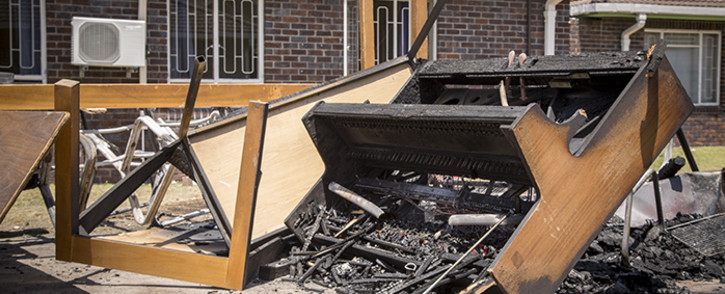 The remains of a piano sit atop a pile of charred furniture outside students' residences at the University of the Western Cape's Bellville campus after protests on Wednesday. Picture: Aletta Harrison/EWN.