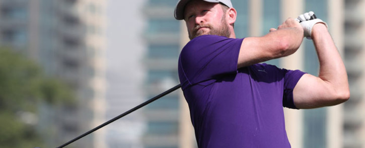 Jamie Donaldson of England plays a shot during the round two of the Dubai Desert Classic at Emirates Golf Club on January 26, 2018, in Dubai. Picture: AFP.