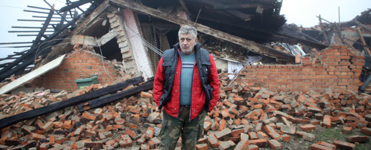 Tomislav Suknaic poses in front of his destroyed house in the village of Majske Poljane, where 5 people died, some 50km from Zagreb on 30 December 2020, a day after the region was hit by a 6.4-magnitude quake. Picture: AFP