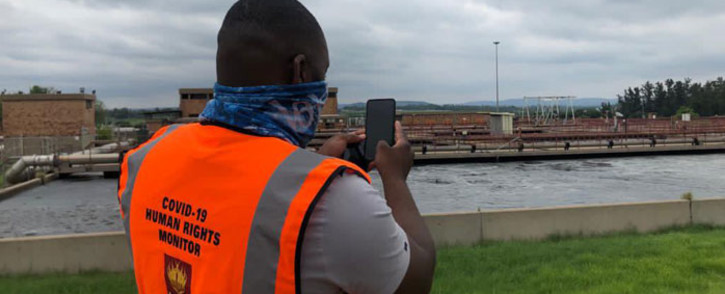 A member of the SAHRC inspects a water treatment plant in Hammanskraal on 30 November 2020. Picture: @SAHRCommission/Twitter