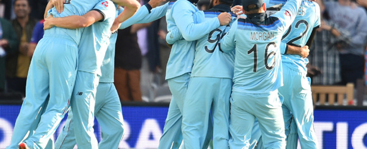 England players celebrate after winning the 2019 Cricket World Cup final between England and New Zealand at Lord's Cricket Ground in London on 14 July 2019. Picture: AFP.