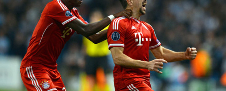 Bayern Munich's French midfielder Franck Ribery celebrates scoring the opening goal with Austrian defender David Alaba during the UEFA Champions League group D match against Manchester City at The City of Manchester stadium on October 2, 2013. Picture: AFP