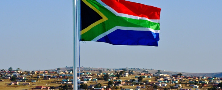 The South African flag flies near Qunu, 26 June 2013. Picture: AFP.