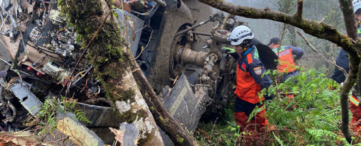 This handout picture released by the Yilan County Fire Department on 2 January 2020 shows rescuers searching for survivors after a military Black Hawk helicopter smashed into mountains in Yilan county near Taipei. Taiwan's top military chief Shen Yi-ming was killed in the helicopter crash, the defence ministry said, just days before the island goes to polls to elect a new president. Picture: AFP