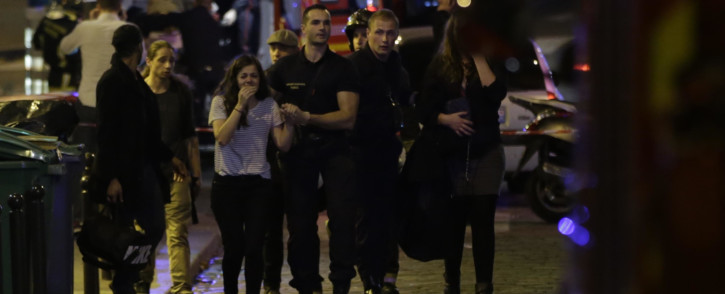 FILE: People being evacuated following an attack at the Bataclan concert venue in Paris, on November 13, 2015. Picture: AFP.