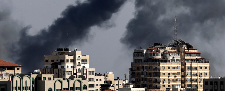 Smoke billows from Israeli air strikes in the Gaza Strip, controlled by the Palestinian Islamist movement Hamas, on 11 May 2021. Israel and Hamas exchanged heavy fire, in a dramatic escalation between the bitter foes sparked by unrest at Jerusalem's flashpoint Al-Aqsa Mosque compound. Picture: Mahmud Hams/AFP