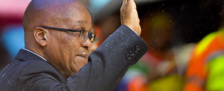 President Jacob Zuma greets the crowds ahead of his keynote address at FNB Stadium during the Nelson Mandela memorial on 10 December 2013. Picture: Herman Verwey/Mandela Pool.