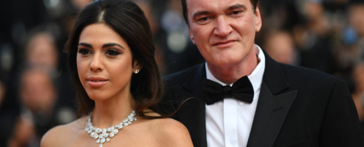 "US film director Quentin Tarantino (R) and his wife Israeli singer Daniella Pick pose as they arrive for the screening of the film ""The Specials (Hors Normes)"" at the 72nd edition of the Cannes Film Festival in Cannes, southern France, on May 25, 2019. Picture: AFP"