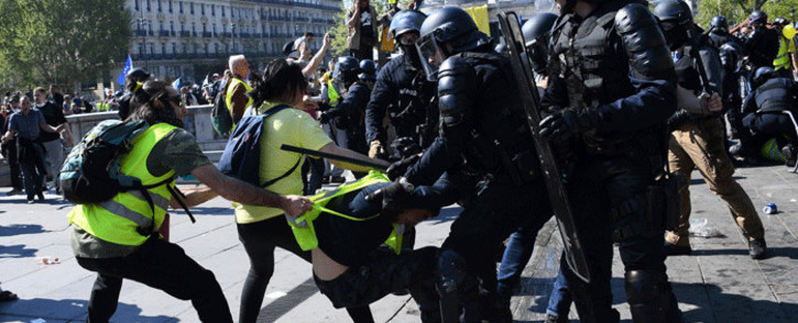 "Anti-riot police clash with protesters during an anti-government demonstration called by the ""Yellow Vests"" (gilets jaunes) movement, on April 20, 2019 in Paris. Picture: AFP."