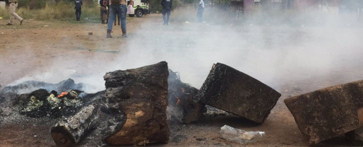 Protesters block roads with burning tyres and rocks as they shut down the area in Hammanskraal on 11 April 2019. Picture: Ahmed Kajee/EWN