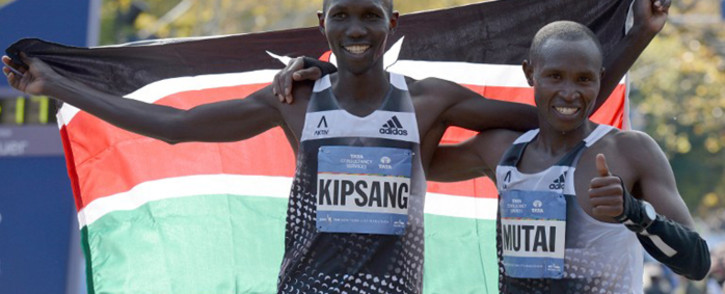 FILE: Wilson Kipsang of Kenya (L) is congratulated by compatriot Geoffrey Mutai after winning the men's 2014 TCS New York City Marathon 2 November 2014 in New York. Picture: AFP