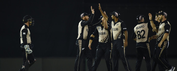 New Zealand's team celebrates after the dismissal of Pakistan's Ahmad Shazad during the World T20 cricket match between New Zealand and Pakistan at the Punjab Cricket Stadium Association Stadium in Mohali on 22 March, 2016. Picture: AFP.