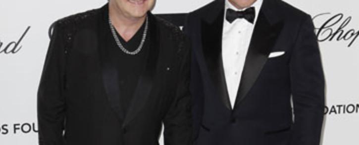Sir Elton John with his husband David Furnish. Picture: AFP