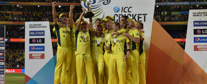 Australia's teammates raise the trophy as they celebrate victory against New Zealand after their 2015 Cricket World Cup final in Melbourne on March 29, 2015. Picture: AFP