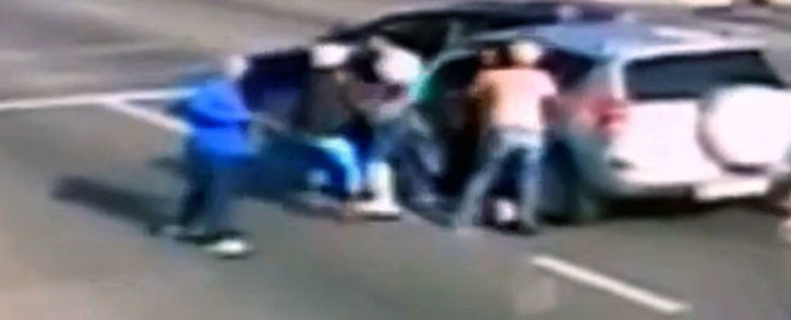 The hijacking of an Ethiopian family on 16 November 2013 in Johannesburg CBD was captured on CCTV cameras and has since gone viral. Picture: YouTube.