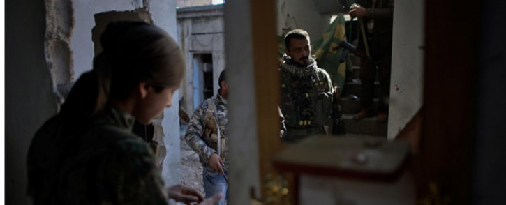 FILE: Syrian rebel fighters prepare to fight against Islamic State group in Ain al-Arab. Picture: AFP.