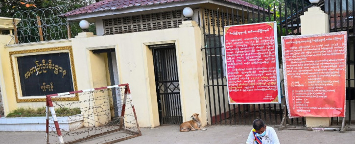 In this file photo taken on 12 April 2021 a man sits in front of Insein prison while waiting to visit inmates in Yangon. Myanmar will release more than 5,000 people jailed for protesting against a February coup which ousted the civilian government, the country's junta chief said 18 October 2021. Picture: AFP