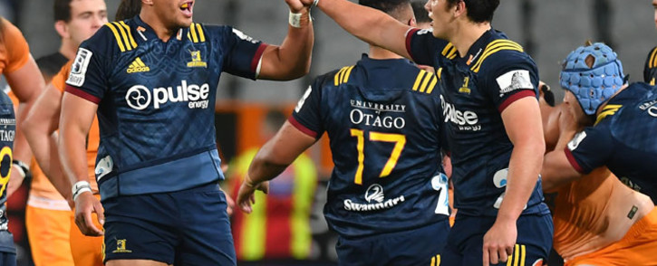 Highlanders' Liam Squire (L) and Thomas Umaga-Jensen celebrate their victory during the Super Rugby match between the Otago Highlanders and the Jaguares of Argentina in Dunedin on 11 May 2019. Picture: AFP