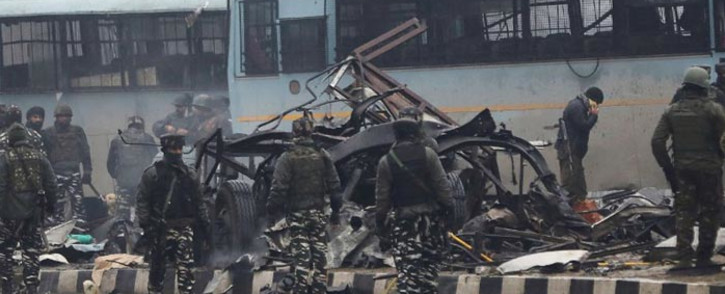 FILE: Indian security forces inspect the remains of a vehicle following an attack on a paramilitary Central Reserve Police Force in Kashmir on 14 February 2019. Picture: AFP.