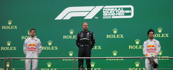 (From left) Second-placed Red Bull's Dutch driver Max Verstappen, winner Mercedes' Finnish driver Valtteri Bottas and third-placed Red Bull's Mexican driver Sergio Perez pose during the podium ceremony after the Formula One Grand Prix of Turkey at the Intercity Istanbul Park in Istanbul on 10 October 2021. Picture: UMIT BEKTAS/AFP