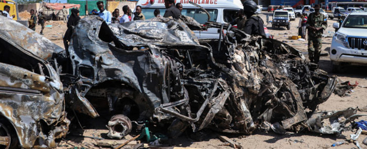 FILE: The wreckage of a car that was destroyed during the car bomb attack is seen in Mogadishu, on 28 December 2019. Picture: AFP