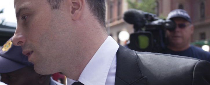 Oscar Pistorius enters the Pretoria High Court for his sentencing on 16 October 2014. Picture: Christa Eybers/EWN