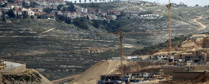 Workers and bulldozers work at a construction site in the Israeli settlement of Givat Zeev near the West Bank city of Ramallah. Picture: AFP
