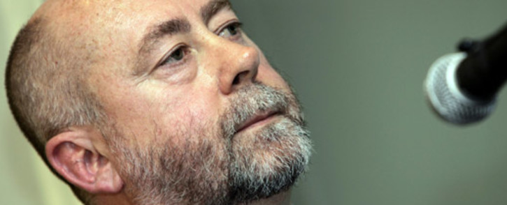 """FILE: South African former apartheid regime Chemical and Biological warfare expert, dubbed """"Dr. death"""", Dr. Wouter Basson gives a press conference and a radio intervew, 13 September 2005. Picture: AFP"""