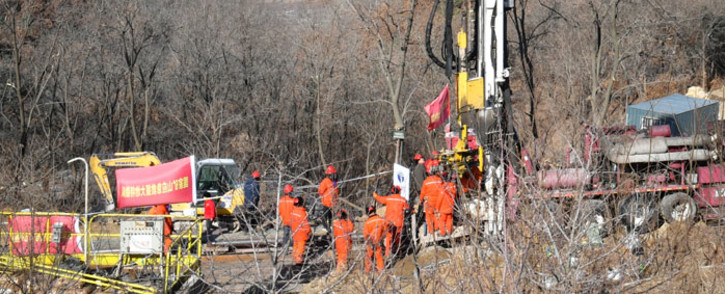 Members of a rescue team work at the site of a gold mine explosion where 22 miners are trapped underground in Qixia, in eastern China's Shandong province on 18 January 2021. Picture: AFP