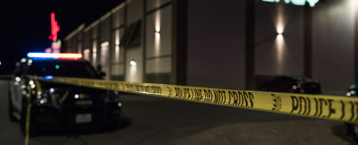Police cars and tape block off a crime scene outside the Cinergy Odessa movie theatre where a gunman was shot and killed on 31 August 2019 in Midland, Texas. Officials say the unidentified suspect killed 5 people and injured 21 in Midland and nearby Odessa. Picture: AFP