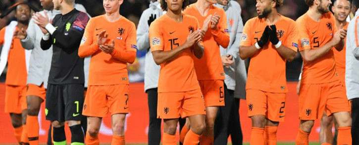Netherlands players celebrate after winning the Uefa Nations League football match between the Netherlands and France at the Feijenoord stadium in Rotterdam on 16 November, 2018. Picture: AFP.