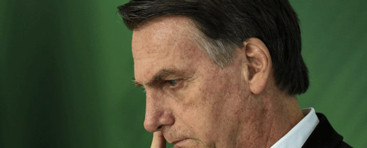 FILE: In this file photo taken on 7 November 2018 Brazilian president Jair Bolsonaro gestures as he delivers a joint press conference with Michel Temer after a meeting in Brasilia. Picture: AFP