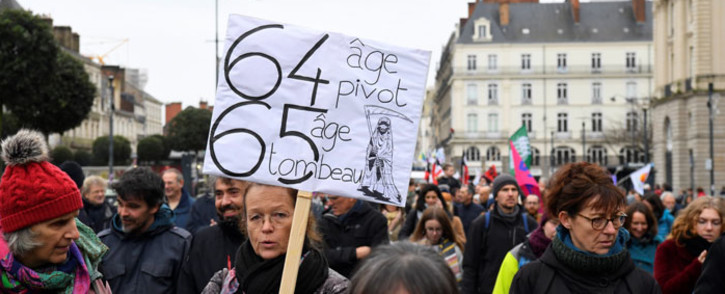 People take part in a demonstration on 17 December 2019 in Rennes, as part of a third countrywide day of protests over a government pensions overhaul. Picture: AFP
