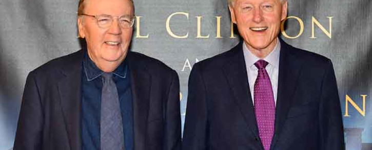 FILE: James Patterson (left) and Bill Clinton sign copies of 'The President Is Missing' at Barnes & Noble, 5th Avenue, on 5 June 2018 in New York City. Picture: Getty Images/AFP