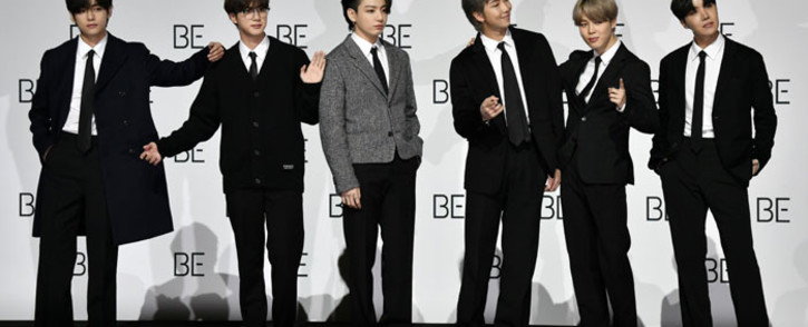 South Korean K-pop boy band BTS members (L to R) V, Jin, Jung Kook, RM, Jimin and J-Hope pose for a photo session during a press conference on BTS new album 'BE (Deluxe Edition)' in Seoul on 20 November 2020. Picture: AFP