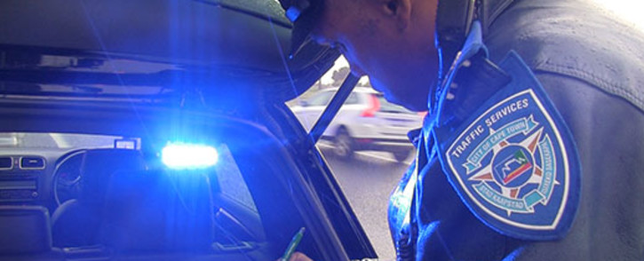 FILE: Traffic Officer who forms part of the Ghost Squad writing out a ticket in Cape Town. Picture: EWN