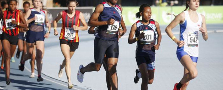 South African middle-distance runner and 2016 Olympic gold medalist Caster Semenya (3rd R) competes in the women's 5,000m final during the Sizwe Medical Fund Athletics South Africa Senior Track and Field Championships held at the Tuks Athletics Stadium in Pretoria on 15 April 2021. Picture: Phill Magakoe/AFP
