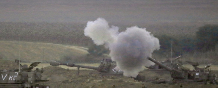 An Israeli artillery fires a 155mm shell towards targets in the Gaza Strip from their position near Israel's border with the Palestinian enclave on 23 July 2014. Picture: AFP.