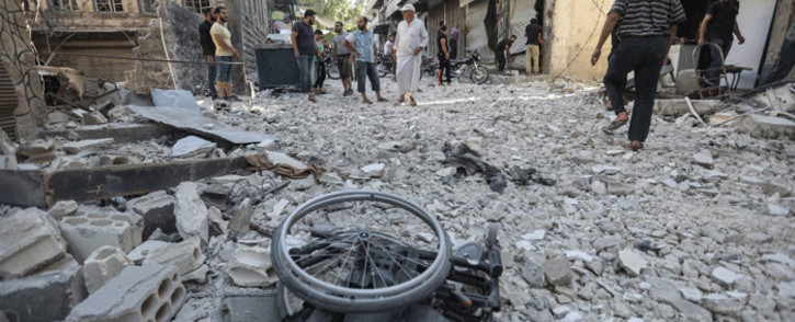 A wheelchair is seen amid the rubble of destroyed buildings following a reported regime air strike on the town of Ariha, in the south of Syria's Idlib province, on July 24, 2019. Picture: AFP.