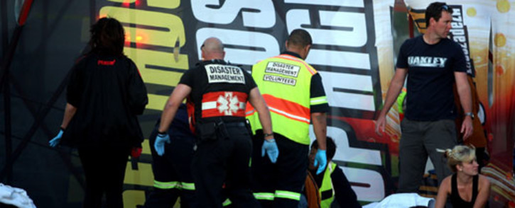Emergency workers attend to a scene where twenty people were injured at a rock concert at the Cape Town Stadium on Wednesday evening, 7 November 2012 when a temporary scaffolding structure collapsed due to strong winds. American rockers Linkin Park were performing at the stadium. Picture: Nardus Engelbrecht/SAPA