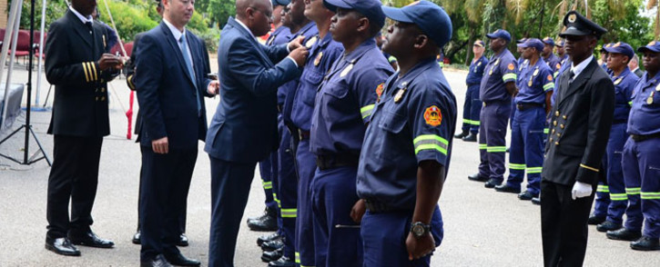 City of Johannesburg Mayor Herman Mashaba hands out medals to the firefighters who battled a fire at the Lisbon Building in Johannesburg in 2018 on 28 January 2019. Picture: @CityofJoburgZA/Twitter
