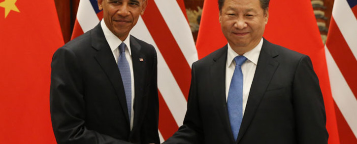 FILE: US President Barack Obama (L) and Chinese President Xi Jinping shake hands during their meeting in China. Picture: AFP