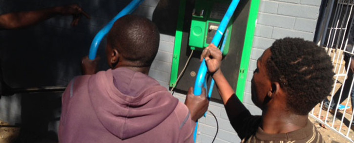 About 300 people carrying rocks, sticks and pangas vandalised the Newclare train station during protests in the area on 6 October 2014. Picture: Vumani Mkhize/EWN.