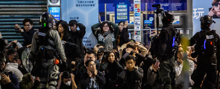Police detain a group of people after a pro-democracy march in Hong Kong on 1 January 2020. Tens of thousands of protesters marched in Hong Kong during a massive pro-democracy rally on New Year's Day, looking to carry the momentum of their movement into 2020. Picture: AFP